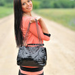 Beautiful girl with a bag — Stock Photo #14866481