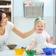 Mother and daughter cooking together and having fun on a kitchen — Stock Photo