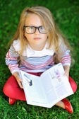 Adorable little girl with a book — Stock Photo