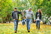 Happy family portrait walking together — Stock Photo