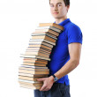 Teenager holding stack of books isolated over white background - Stock Photo