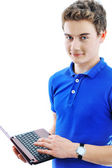 Student guy using laptop isolated over white background — Stock Photo