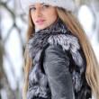 Fur fashion hat. Beautiful girl in furry hat. Winter woman portr — Stock Photo