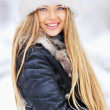 Royalty-Free Stock Photo: Winter portrait of young woman in fur hat