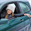 Beautiful young happy woman in car showing the keys - outdoors — Stock Photo