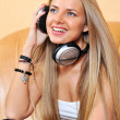 Beautiful woman with headphones listening to the music — Stock Photo #18692221