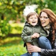 Mother and son having fun in a park — Stock Photo #19149193