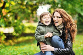 Mother and son having fun in a park — Stock Photo