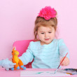 Sweet little girl painting at home — Stock Photo