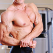 Stock Photo: Muscular man torso - closeup