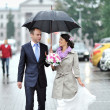 Royalty-Free Stock Photo: Wedding couple waking by the rain in an old town