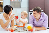 Happy family on a kitchen — Stock Photo