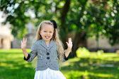 Sweet little girl having fun in a park — Stock Photo