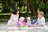 Happy family in a park — Stock Photo