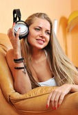 Listening to music - beautiful woman portrait relaxing at home h — Stock Photo
