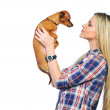 Beautiful woman holding her little puppy posing isolated on whit — Stock Photo