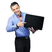 Attractive young man pointing on notebook computer. Isolated on — Stock Photo