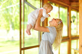 Happy mother with baby outdoors — Stock Photo