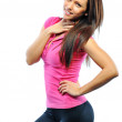 Stock Photo: Smiling happy female fitness model looking at camera