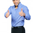 Royalty-Free Stock Photo: Happy casual young man showing thumb up and smiling isolated on
