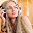 Beautiful girl listening to the music - closeup portrait  — Stock Photo