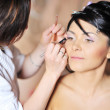 Young beautiful bride applying wedding make-up by make-up artist — Foto Stock