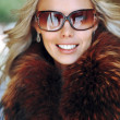 Outdoor portrait of a beautiful woman face in sunglasses - close - Stock Photo