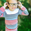 Attractive sweet little girl wearing glasses - outdoor portrait  — Stock Photo