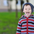 Little boy portrait sticking out his tongue - outdoor — Stock Photo