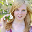 Beautiful girl in blooming tree - spring sunny portrait — Stock Photo