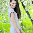 Young beautiful girl smiling - outdoor portrait — Stock Photo