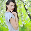 Young brunette woman portrait in spring — Stock Photo