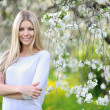 Stock Photo: Spring woman portrait smiling outdoors in the park