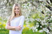 Spring woman portrait smiling outdoors in the park — Stock Photo