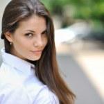 Beautiful brunette woman portrait - outdoor — Stock Photo #26509597