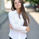 Black hair beautiful young woman portrait posing outdoor — Stock Photo #26509619