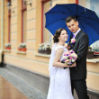 Happy wedding couple - bride and groom portrait outdoor — Stock Photo