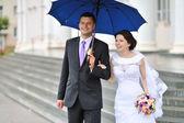 Happy bride and groom portrait outdoors — Stock Photo