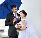 Outdoor portrait of a bride and groom — Stock Photo