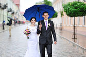 Happy wedding couple walking together — Stock Photo