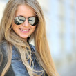Beautiful woman face wearing sunglasses - closeup — Stock Photo