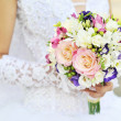 Stock Photo: Bride is holding wedding bouquet