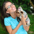 Attractive young girl playing with her yorkshire terrier puppy o — Stock Photo
