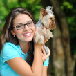 Young girl with her yorkshire terrier puppy outdoors  — Stock Photo