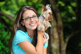 Young girl with her yorkshire terrier puppy outdoors — Stok fotoğraf
