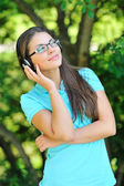 Beautiful girl enjoying music - outdoor portrait — ストック写真