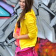Beautiful young smiling girl in bright clothes — Stock Photo