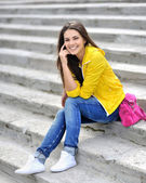 Young beautiful fashionable girl smiling — Stock Photo
