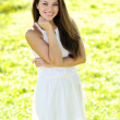 Portrait of young beautiful woman in a park — Stock Photo #30772153