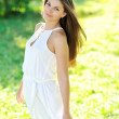Beautiful girl in the garden on a sunny day — Stock Photo